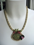 Here's my first 3D RAW (right angle weave) necklace.  The Green Brecciated Jasper cabochon is embellished with brick st