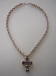 For the cross: Swarovski crystals 8mm round Tanzanite, size 15/0 Japanese seed beads, 24K plated Charlottes, sterling si
