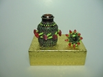Beaded eye drops bottle #5. The plain bottle is 1 and 1/2 inches tall (4cm) and the diameter is almost 1 inch (2,5 cm).