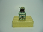 Beaded eye drops bottle #7. The plain bottle is 1 and 1/2 inches tall (4cm) and the diameter is almost 1 inch (2,5 cm).
