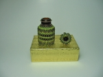 Beaded eye drops bottle #8. The plain bottle is 1 and 1/2 inches tall (4cm) and the diameter is almost 1 inch (2,5 cm).