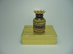 Beaded eye drops bottle #9. The plain bottle is 1 and 1/2 inches tall (4cm) and the diameter is almost 1 inch (2,5 cm).