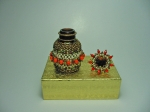 Beaded eye drops bottle #10. The plain bottle is 1 and 1/2 inches tall (4cm) and the diameter is almost 1 inch (2,5 cm).