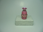 Beaded Bottle # 11.  The plain bottle is only 1 and 1/2 inches tall (4cm) and the diameter is 0.67 inches (17mm).  Size
