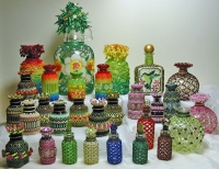 A bunch of beaded bottles