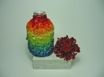 Beaded Bottle # 18 This bottle is much larger than the previous ones. It measures cm.7.5 x 4 (inches 2.95 x 1.57); the c